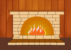 Burning fireplace at home on a wooden background. Royalty Free Stock Photos