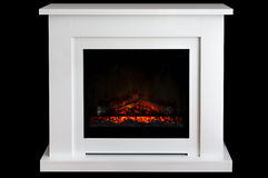 Burning fireplace isolated on black background Stock Photos