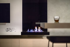 Burning fireplace in modern interior Royalty Free Stock Photo