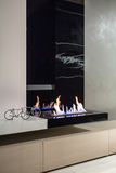 Burning fireplace in modern interior Stock Photography