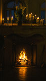 Burning Fireplace in winter time Stock Photos