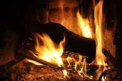 Burning fireplace Stock Photos