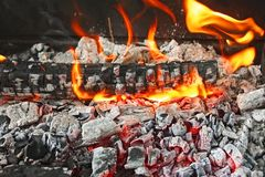 Burning firewood with ashes Royalty Free Stock Photo
