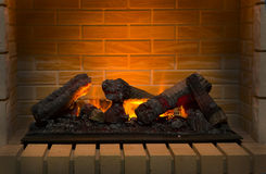 Burning firewood in brick fireplace Royalty Free Stock Photos