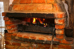 Burning firewood in brick furnace Stock Photography