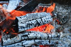 Burning firewood Campfire fireplace barbecue. Burning firewood. charcoal burning ready to barbecue grill closeup fireplace. Heat from the fire Campfire royalty free stock photo