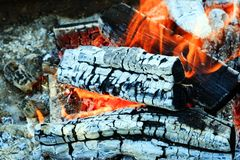 Burning firewood Campfire fireplace. Burning firewood, charcoal burning ready to grill closeup fireplace. Heat from the fire Campfire stock photography
