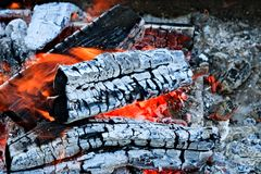Burning firewood Campfire fireplace. Burning firewood, charcoal burning ready to grill closeup fireplace. Heat from the fire Campfire royalty free stock photos