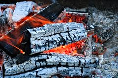 Burning firewood Campfire fireplace. Burning firewood, charcoal burning ready to grill closeup fireplace. Heat from the fire Campfire stock photo