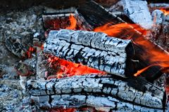Burning firewood Campfire fireplace. Burning firewood, charcoal burning ready to grill closeup fireplace. Heat from the fire Campfire stock images