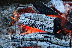Burning firewood Campfire fireplace. Burning firewood, charcoal burning ready to grill closeup fireplace. Heat from the fire Campfire royalty free stock images
