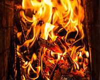 Burning firewood. In the fire-place Royalty Free Stock Photo