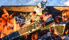 Burning firewood in the fireplace stock images