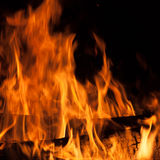 Burning firewood. In the fireplace close up stock images