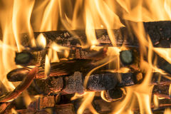 Burning firewood in the fireplace close up, BBQ fire, burning charcoal background, barbeque grill. Royalty Free Stock Photography