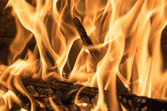 Burning firewood in the fireplace close up, BBQ fire, burning charcoal background, barbeque grill. Burning firewood in the fireplace close up, BBQ fire, burning stock photo