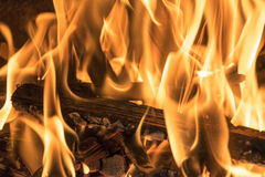 Burning firewood in the fireplace close up, BBQ fire, burning charcoal background, barbeque grill. Burning firewood in the fireplace close up, BBQ fire, burning royalty free stock image