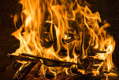 Burning firewood in the fireplace close up, BBQ fire, charcoal background. Royalty Free Stock Photos