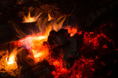 Burning firewood in the fireplace Stock Photo