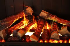Burning firewood in the fireplace, closeup shot stock photo