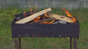 Burning firewood in the grill. Burning firewood in a grill stock footage