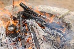 Burning firewood grill Stock Image