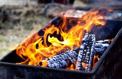 Burning firewood in the old grill Royalty Free Stock Images