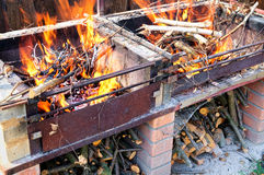 Burning firewood in self made brick and metal Stock Photo