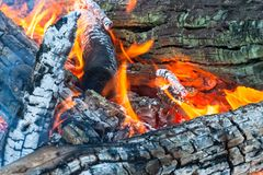 Burning firewoods ember in fire flame Royalty Free Stock Photos