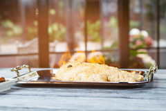 Burning fish on tray. Stock Photography
