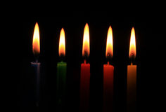 Burning five colors candles Stock Photos