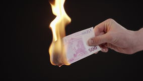 Burning five hundred Euro