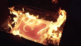 Burning the flag of Turkey stock footage