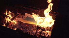 Burning the flag of Ukraine stock video