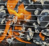 Burning flames and barbecue. Closeup Stock Photo