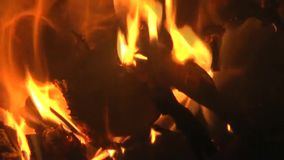 Burning flames in fire. Close up of burning flames over glowing embers in fire stock video footage