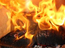 Burning flames in the fireplace close up Stock Photo