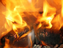 Burning flames in the fireplace close up Royalty Free Stock Photos
