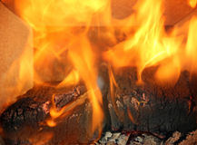 Burning flames in the fireplace close up Royalty Free Stock Image