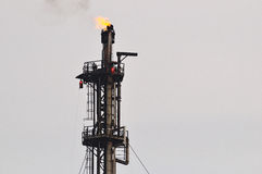 Burning flare at oil refinery Stock Photos