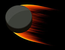 Burning flying puck Royalty Free Stock Image