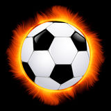 Burning football ball Royalty Free Stock Photo