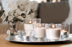 Free Burning Fragrance Candles On Table At Cozy Home Stock Images - 160495234