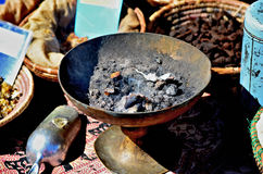 Burning Frankincense. Street vendor selling frankincense during the 2012 Annual Street Fair in Maspeth New York Stock Photo