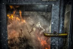 A burning furnace. A close-up of a retro furnace with a burning fire Stock Image