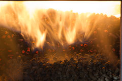 Burning in the furnace pellets from pine Royalty Free Stock Image