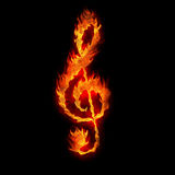 Burning g clef sign. Fire on black Royalty Free Stock Photos