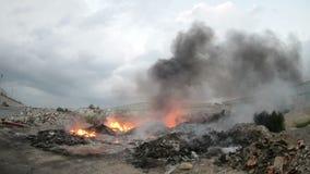 Burning garbage in cloudy day closeup Royalty Free Stock Photos