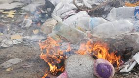 Burning garbage dump, ecological pollution stock footage