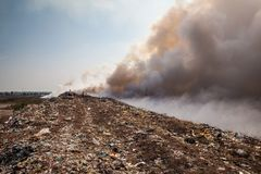 Burning garbage heap of smoke Stock Photos